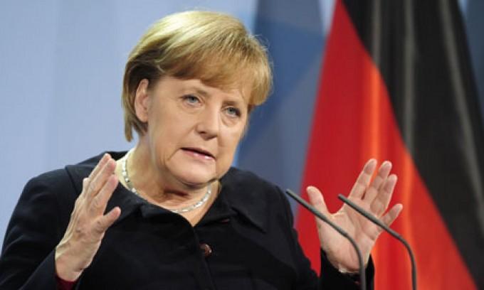 Angela Merkel deplânge proiectul lui Donald Trump de a retrage SUA din Tratatul Comercial Transpacific