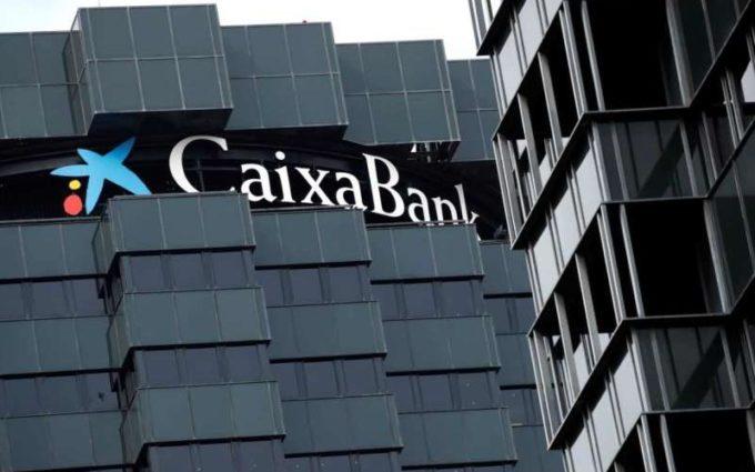 Caixabank şi Bankia formează cel mai mare grup bancar spaniol, cu active de 650 de miliarde de dolari
