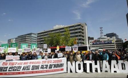 China cere SUA și Coreii de Sud retragerea sistemului antirachetă THAAD