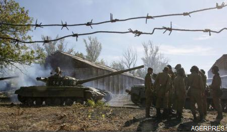 Forțele guvernamentale și rebelii proruși încep retragerea armamentului greu desfășurat în regiunea Donețk din Ucraina