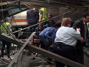 HOBOKEN, NJ - SEPTEMBER 29:  Passengers rush to safety after a NJ Transit train crashed in to the platform at the Hoboken Terminal September 29, 2016 in Hoboken, New Jersey. (Photo by Pancho Bernasconi/Getty Images)